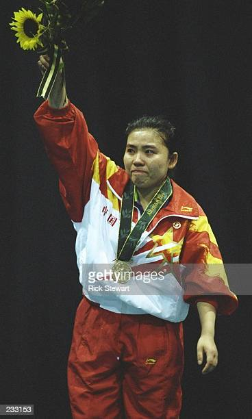 Yaping Deng of China with the gold medal for the womens table tennis singles at the Georgia World Congress Centre at the 1996 Centennial Olympic...
