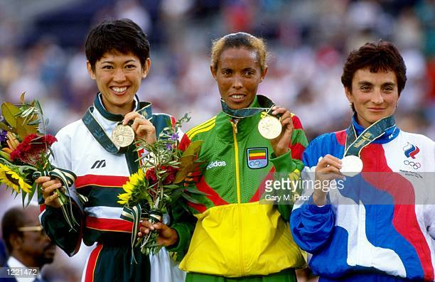 Yuko Arimori of Japan Fatuma Roba of Ethiopia and Valentina Yegorova of Russia pose with their medals after the Marathon event of the 1996 Centennial...