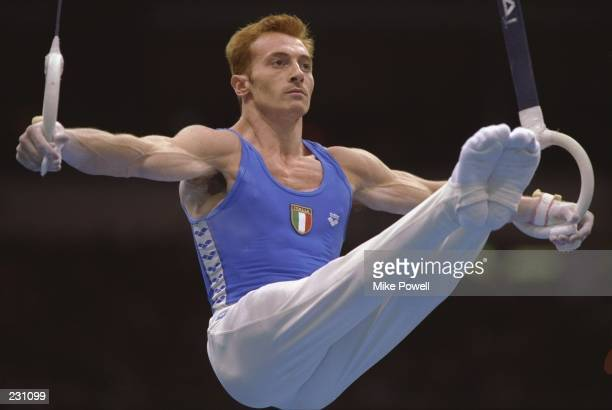 Yuri Chechi of Italy performs on the rings during the men''s team optionals at the Georgia Dome at the Centennial Olympic Games in Altanta Georgia