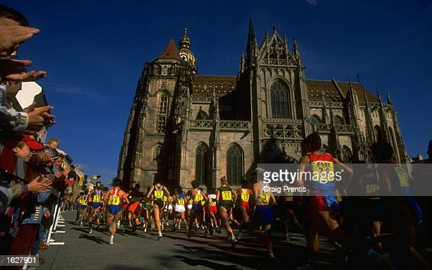 A general view of runners passing a church during the IAAF World Half Marathon Championship in Kosice Slovakia Mandatory Credit Craig Prentis...