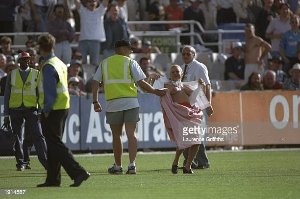 A streaker is caught by groundstaff during the 3rd Test Match between England and Australia at Old Trafford Manchester Australia won the match by 268...