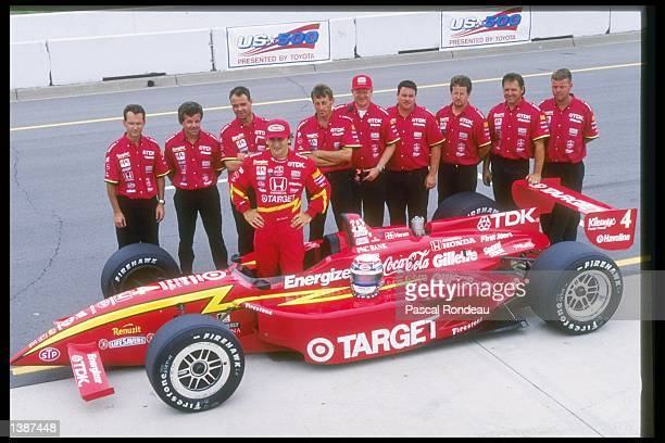 Alex Zanardi of Italy poses with his team and car at the United States 500 at the Michigan Speedway in Brooklyn Michigan Mandatory Credit Pascal...