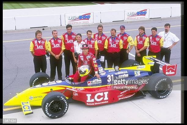 Andre Ribiero of Brazil poses with his team and car at the United States 500 at the Michigan Speedway in Brooklyn Michigan Mandatory Credit Pascal...