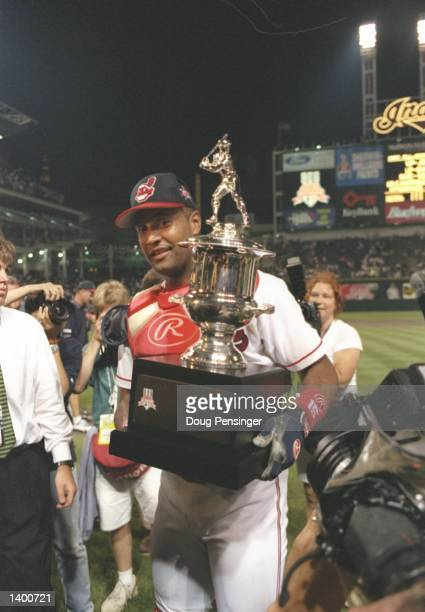 Catcher Sandy Alomar of the Cleveland Indians carries a trophy at the AllStar Game at Jacobs Field in Cleveland Ohio Mandatory Credit Doug Pensinger...