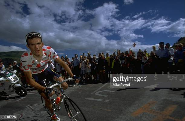 Festina rider Richard Virenque wearing the polkadot King of the Mountains jersey of France in action during Stage 13 of the Tour de France between St...