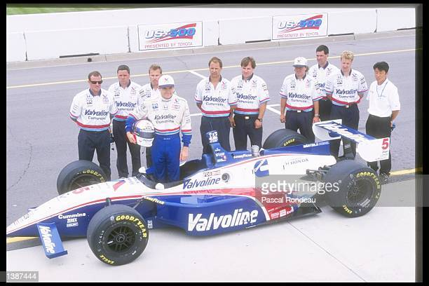 Gil de Ferran of Brazil poses with his team and car at the United States 500 at the Michigan Speedway in Brooklyn Michigan Mandatory Credit Pascal...