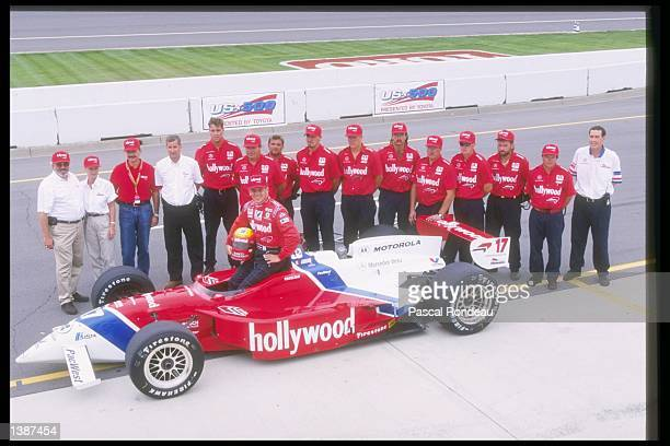 Mauricio Gugelmin of Brazil poses with his car and team at the United States 500 at the Michigan Speedway in Brooklyn Michigan