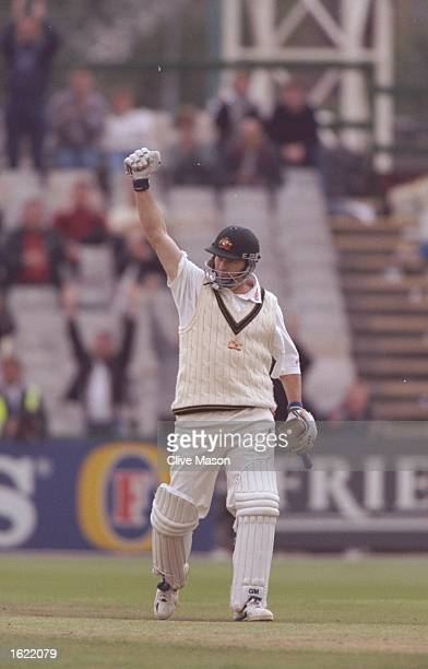 Steve Waugh of Australia punches the air in jubilation after reaching 100 runs during the third test match against England at Old Trafford in...