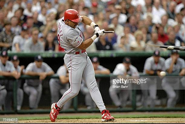 American League member Juan Gonzalez of the Texas Rangers swings and breaks his bat during the All-Star Game at Coors Field in Denver, Colorado. The...