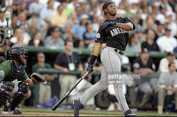 American League member Ken Griffey Jr. #24 of the Seattle Mariners watches after hitting the ball during the All-Star Home Run Derby at Coors Field...