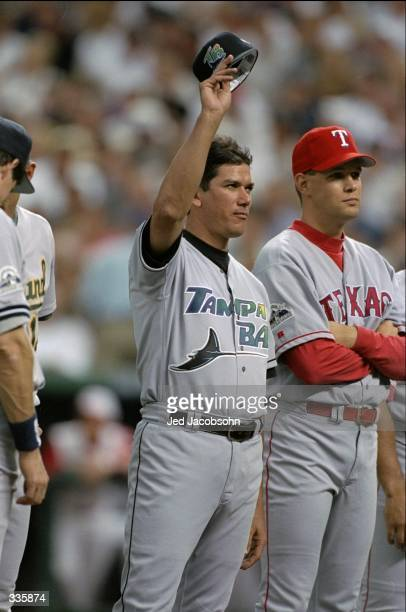 American League member Rolando Arrojo of the Tampa Bay Devil Rays acknowledges the fans during the All-Star Game at Coors Field in Denver, Colorado....
