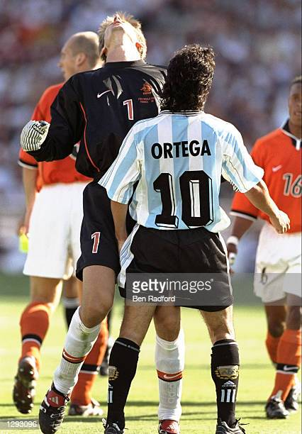 Ariel Ortega of Argentina headbutts Edwin van der Sar of Holland after having an appeal for a penalty turned down during the World Cup quaterfinal...