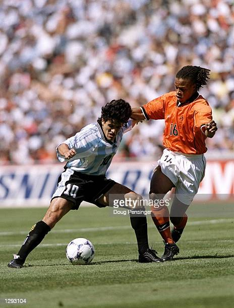 Ariel Ortega of Argentina is put under pressure by Edgar Davids of Holland during the World Cup quarterfinal match at the Stade Velodrome in...