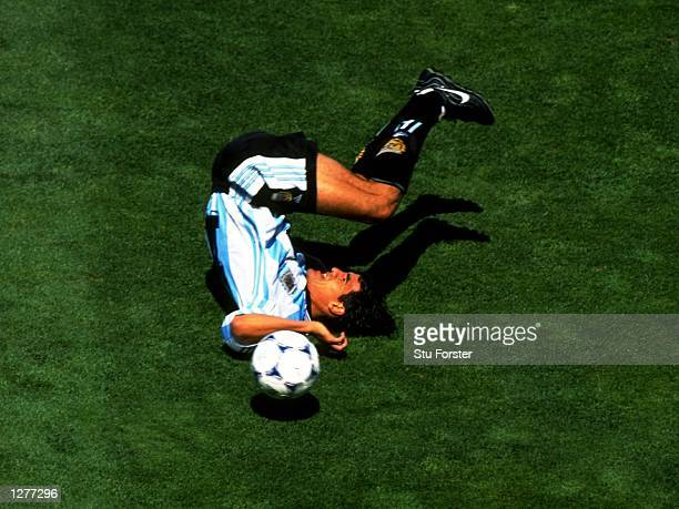 Ariel Ortega of Argentina takes a tumble during the World Cup quarterfinal against Holland at the Stade Velodrome in Marseilles Holland won the match...