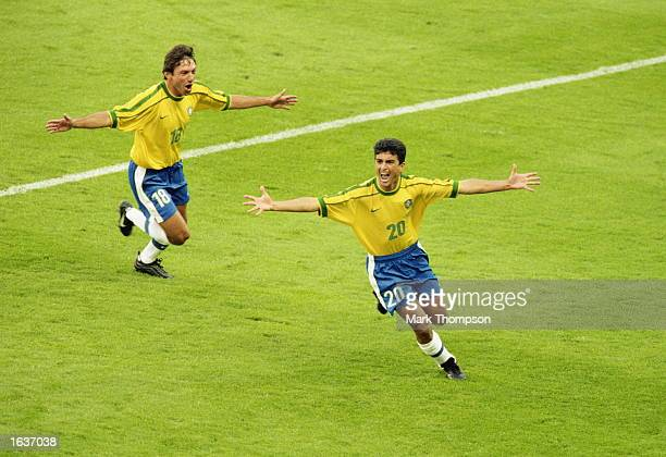 Bebeto of Brazil celebrates with team mate Leonardo after scoring in the World Cup quarterfinal match against Denmark at the Stade de la Beaujoire in...