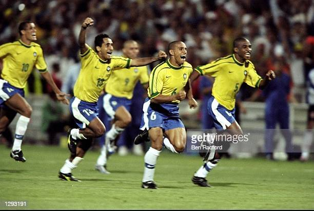 Brazil celebrate after victory in the World Cup semi-final against Holland at the Stade Velodrome in Marseille, France. Brazil won on penalties. \...