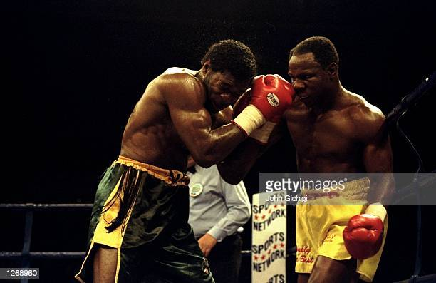 Carl Thompson of Great Britain defends himself against Chris Eubank also of Great Britain during their WBO Cruiserweight bout in Sheffield England...