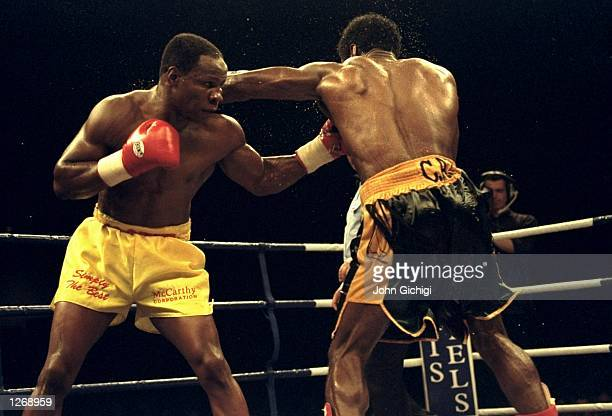 Carl Thompson of Great Britain exchanges blows with Chris Eubank also of Great Britain during their WBO Cruiserweight bout in Sheffield England...