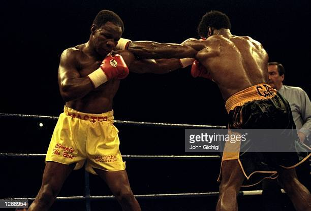 Carl Thompson of Great Britain lands a blow to the head of opponent Chris Eubank of Great Britain during their WBO Cruiserweight bout in Sheffield...
