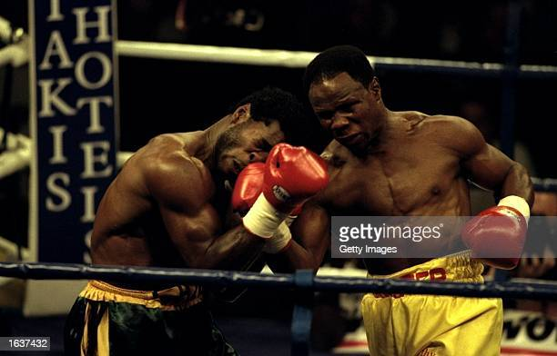 Carl Thompson of Great Britain receives a blow to the face from opponent Chris Eubank of Great Britain during their WBO Cruiserweight bout in...