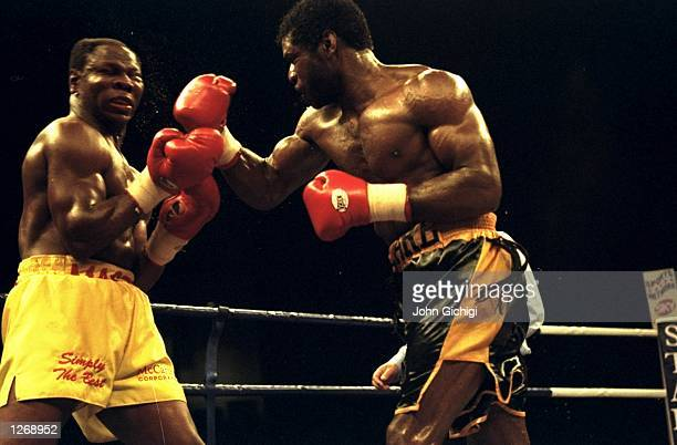 Carl Thompson of Great Britain throws a punch to the head of opponent Chris Eubank of Great Britain during their WBO Cruiserweight bout in Sheffield...