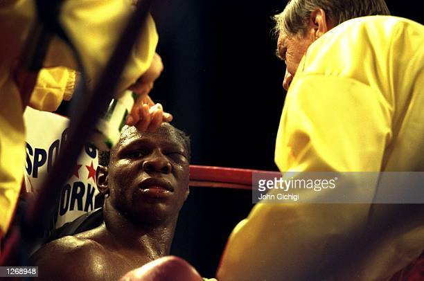 Chris Eubank of Great Britain receives treatment to his swollen left eye during the WBO Cruiserweight bout against Carl Thompson of Great Britain in...