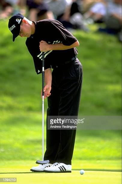 David Carter of England putts during the Murphy's Irish Open at Druids Glen Golf Club in Dublin, Republic of Ireland. Carter won the event. \...