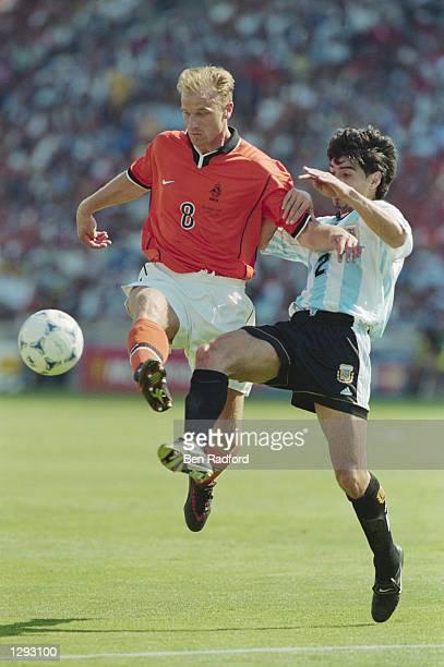 Dennis Bergkamp of Holland goes past Roberto Ayala of Argentina during the World Cup quarterfinal match at the Stade Velodrome in Marseille France...