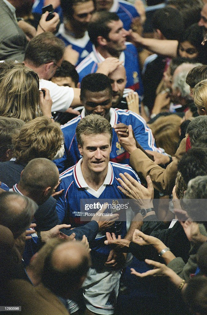 France captain Didier Deschamps leads his team up to the presentation box after victory in the World Cup Final against Brazil at the Stade de France in St Denis. France won 3-0. \ Mandatory Credit: Ross Kinnaird /Allsport