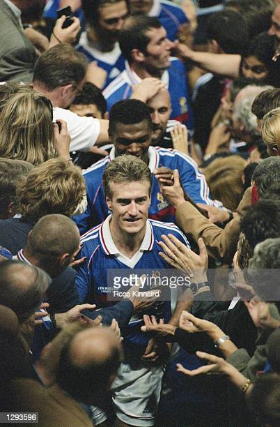 France captain Didier Deschamps leads his team up to the presentation box after victory in the World Cup Final against Brazil at the Stade de France...