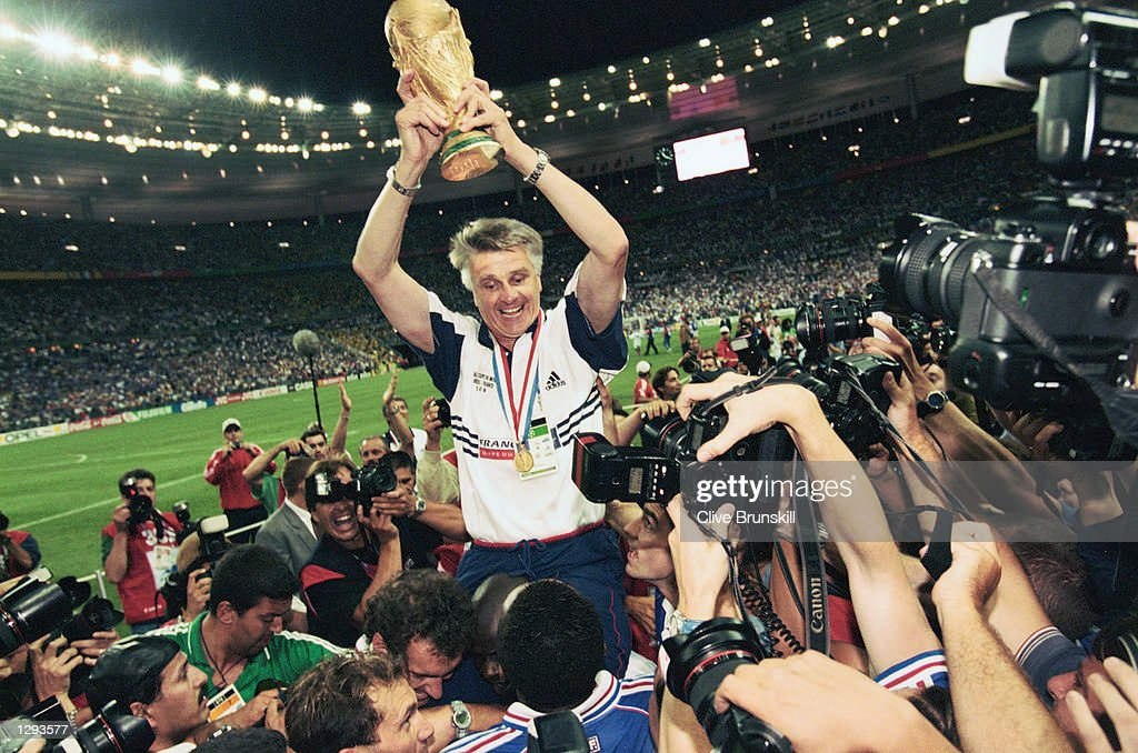 France coach Aime Jacquet lifts the trophy after victory in the World Cup Final against Brazil at the Stade de France in St Denis. France won 3-0. \ Mandatory Credit: Clive Brunskill /Allsport
