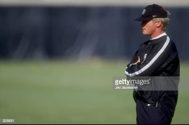 Head coach Jon Gruden of the Oakland Raiders looks on during the 1998 Oakland Raiders Training Camp in Napa California Mandatory Credit Jed Jacobsohn...