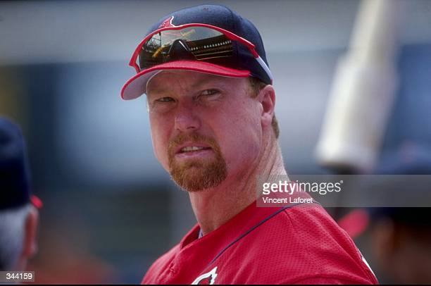 Infielder Mark McGwire of the St Louis Cardinals looks on during a game against the Houston Astros at the Busch Stadium in St Louis Missouri The...