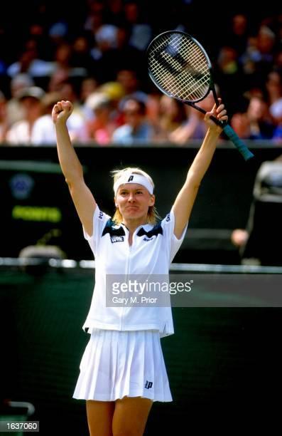 Jana Novotna of the Czech Republic celebrates her victory over Venus Williams during the 1998 Wimbledon Championships played at Wimbledon London...