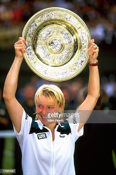 Jana Novotna of the Czech Republic holds her trophy during the 1998 Wimbledon Championships played at Wimbledon London England Mandatory Credit Mike...