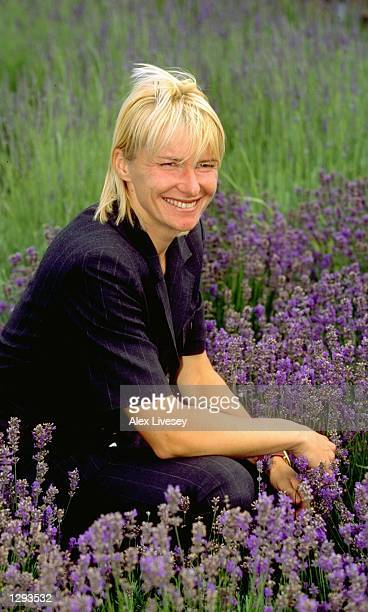Jana Novotna of the Czech Republic poses with the trophy for the cameras after wimming the 1998 Wimbledon Championships played at Wimbledon London...