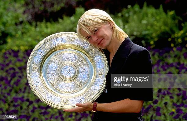 Jana Novotna of the Czech Republic poses with the trophy for the cameras after wimming the 1998 Wimbledon Championships played at Wimbledon, London,...