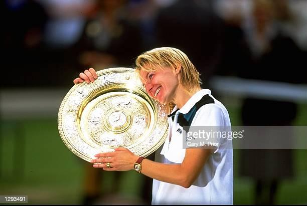 Jana Novotna of the Czech Republic poses with the trophy after the 1998 Wimbledon Championships played at Wimbledon, London, England. \ Mandatory...