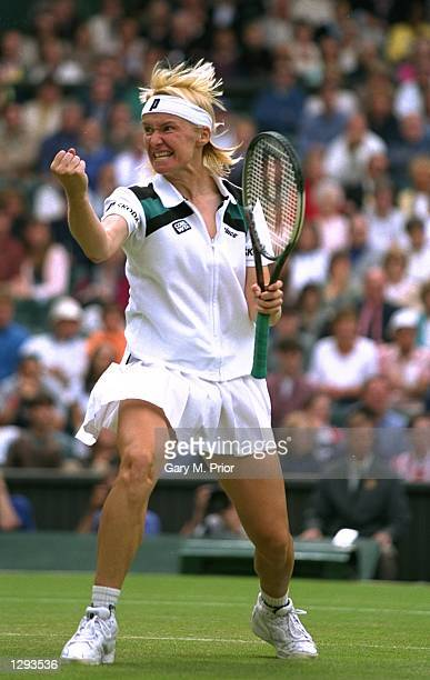 Jana Novotna of the Czech Republic punches the air after beating Venus Williams 7-5, 7-6 in the quarter-finals of the Lawn Tennis Championships at...