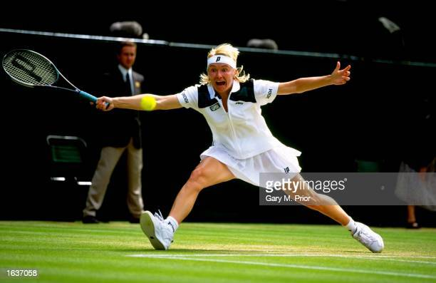 Jana Novotna of the Czech Republic stretches for a forehand during the 1998 Wimbledon Championships played at Wimbledon London England Mandatory...