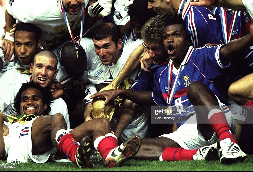 Joy for France as they celebrate with the trophy after victory in the World Cup Final against Brazil at the Stade de France in St Denis. Zidane scored twice as France won 3-0. \ Mandatory Credit: Ben Radford /Allsport