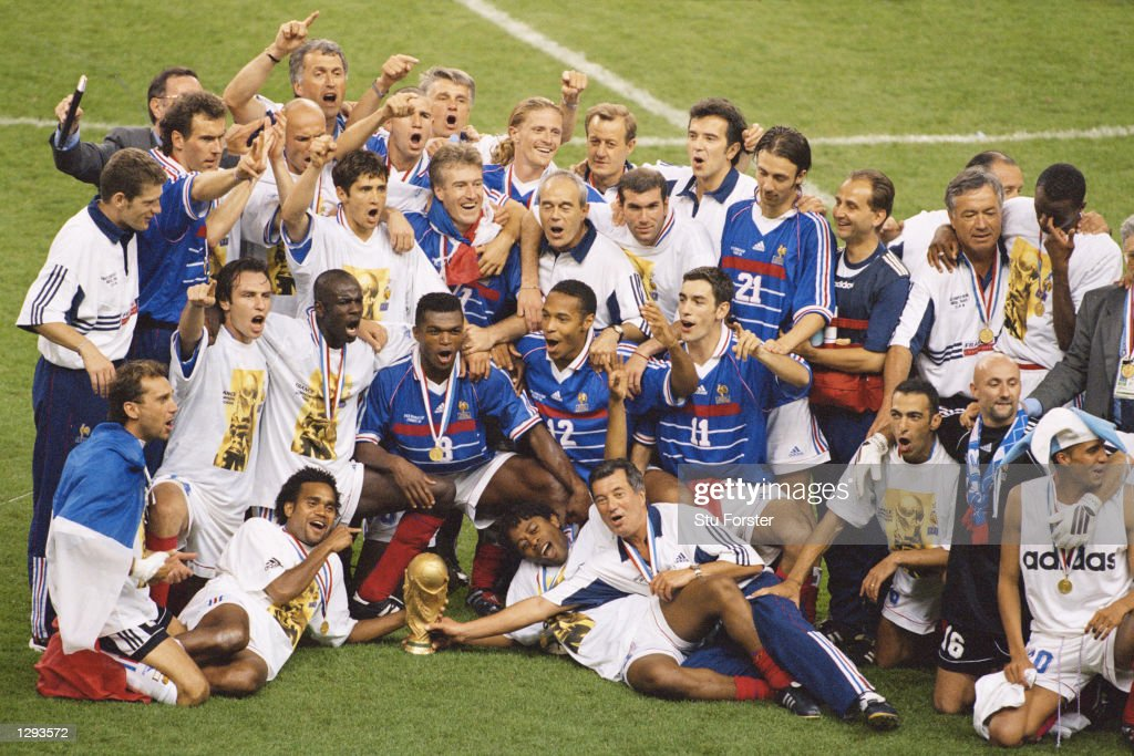 Joy for France as they celebrate with the trophy after victory in the World Cup Final against Brazil at the Stade de France in St Denis. Zidane scored twice as France won 3-0. \ Mandatory Credit: Stu Forster /Allsport