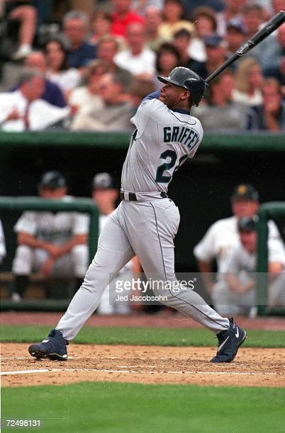 Ken Griffey Jr. #24 of the American League swings at the ball during the MLB All-Star Game against the National League at Coors Field in Denver,...