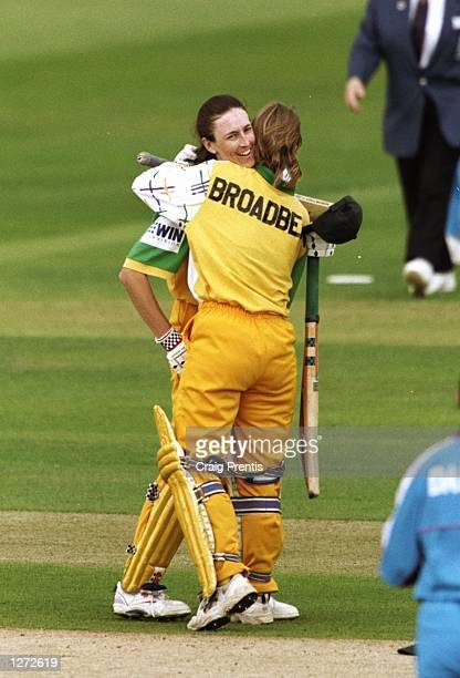 Lisa Keightley of Australia celebrates her century with team mate Joanne Broadbent during the fifth One Day match against England at Lord's in London...