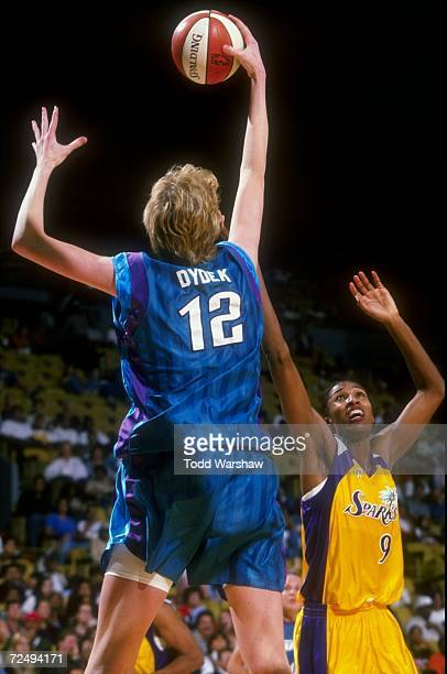 Lisa Leslie of the Los Angeles Sparks attempts to steal the ball from Margo Dydek of the Utah Starzz during a game at the Great Western Forum in...