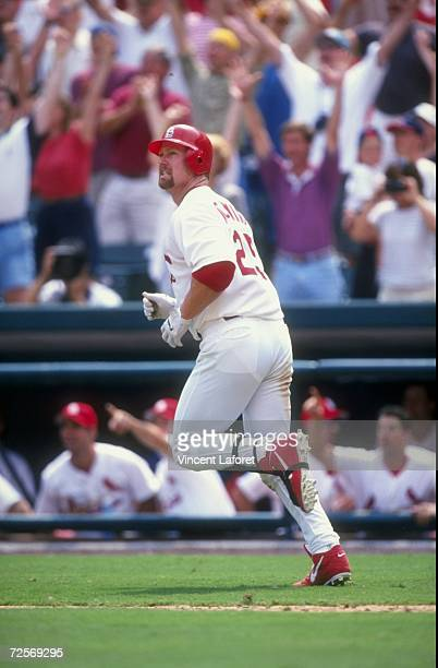 Mark McGwire of the St Louis Cardinals hits his 38th home run during the 11th inning of the game against the Houston Astros at the Busch Stadium in...