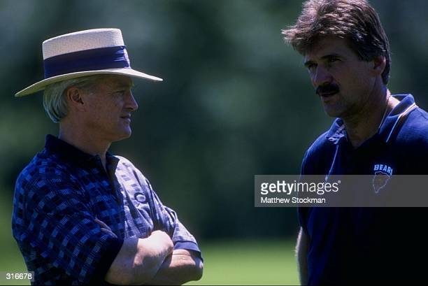 Michael B McCaskey and Chicago Bears head coach Dave Wannstedt talk during the Chicago Bears Training Camp in Lake Forest Illinois Mandatory Credit...