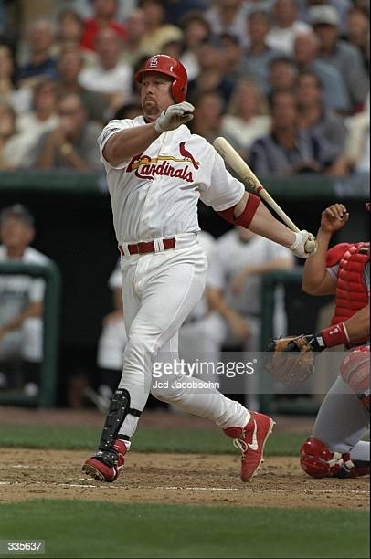 National League member Mark McGwire of the St Louis Cardinals hits a pitch during the AllStar Game at Coors Field in Denver Colorado The American...