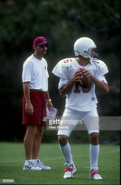Offensive coordinator Marc Trestman of the Arizona Cardinals observes quarterback Jake Plummer during the Cardinals training camp at the Northern...