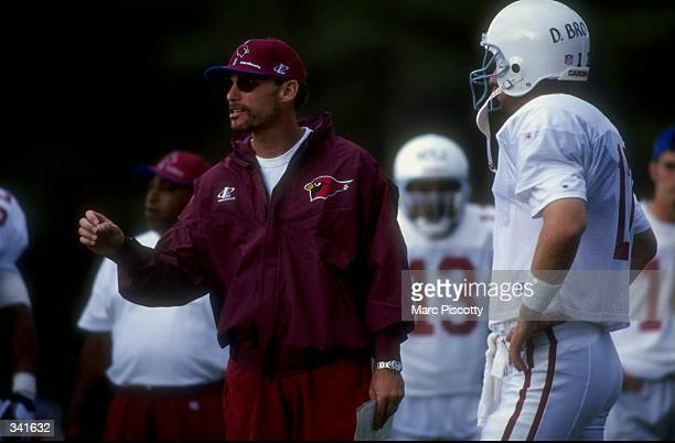 Offensive coordinator Marc Trestman of the Arizona Cardinals gives instructions to players during the 1998 Arizona Cardinals training camp at the...